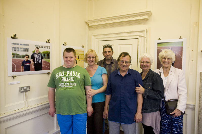 David Rycroft + Family with his portrait at Image17 exhibition