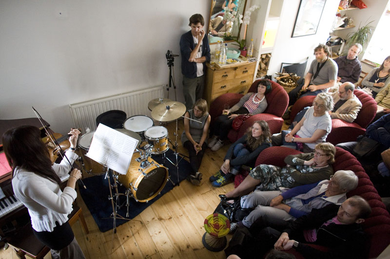 Violinist Lucy Russell playing at concert in Sarah Nicolls Home