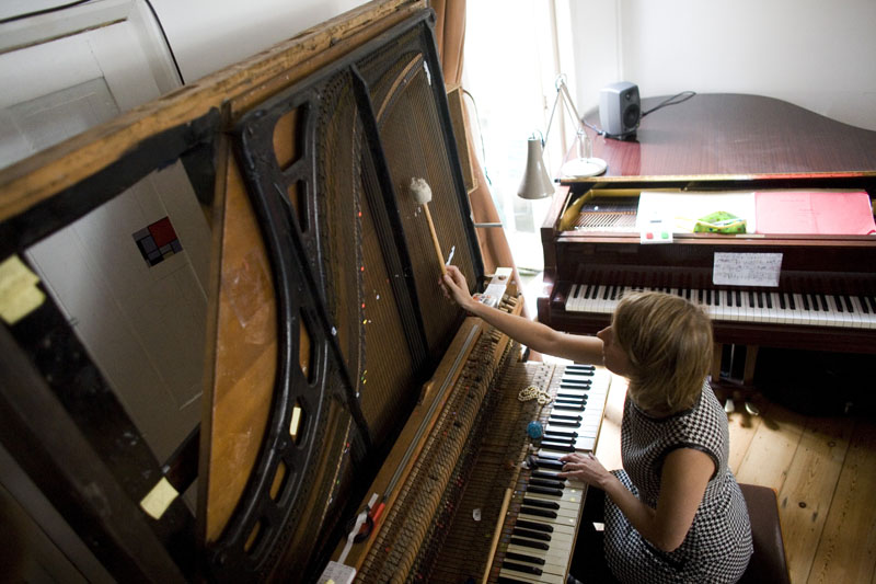 Sarah Nicolls playing her 'Inside-out Piano' at a concert in her home