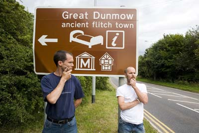 Chris and Jeff, with the Great Dunow sign
