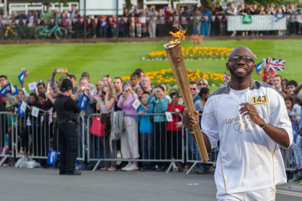 Fabrice Muamba carrying the Olympic Flame in Waltham Forest