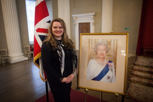 A transformed Kalleen posing with Her Maj