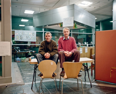 A series of portraits capturing the respectful and dignified relationship that forms between guests and volunteers at a Christmas homeless centre in London.  Photographed using a Mamiya 7  December 2010